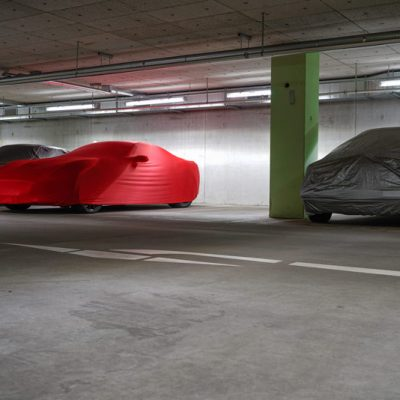 Covered luxury cars in the garage